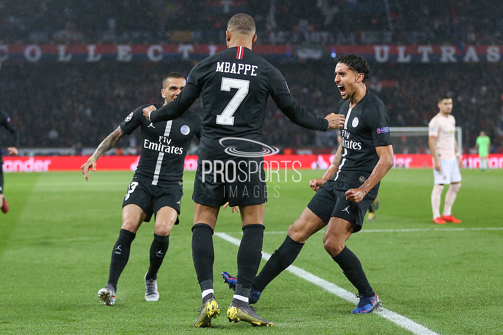 Kylian Mbappe of Paris Saint-Germain celebrates with Marquinhos of Paris Saint-Germain and Dani Alves of Paris Saint-Germain after a goal from Juan Bernat of Paris Saint-Germain not in picture 1-1 during the Champions League Round of 16 2nd leg match between Paris Saint-Germain and Manchester United at Parc des Princes, Paris, France on 6 March 2019.