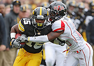 October 03, 2009: Iowa wide receiver Derrell Johnson-Koulianos (15) is hit by Arkansas State defensive back Daylan Walker (13) during the second half of the Iowa Hawkeyes' 24-21 win over the Arkansas State Red Wolves at Kinnick Stadium in Iowa City, Iowa on October 03, 2009.