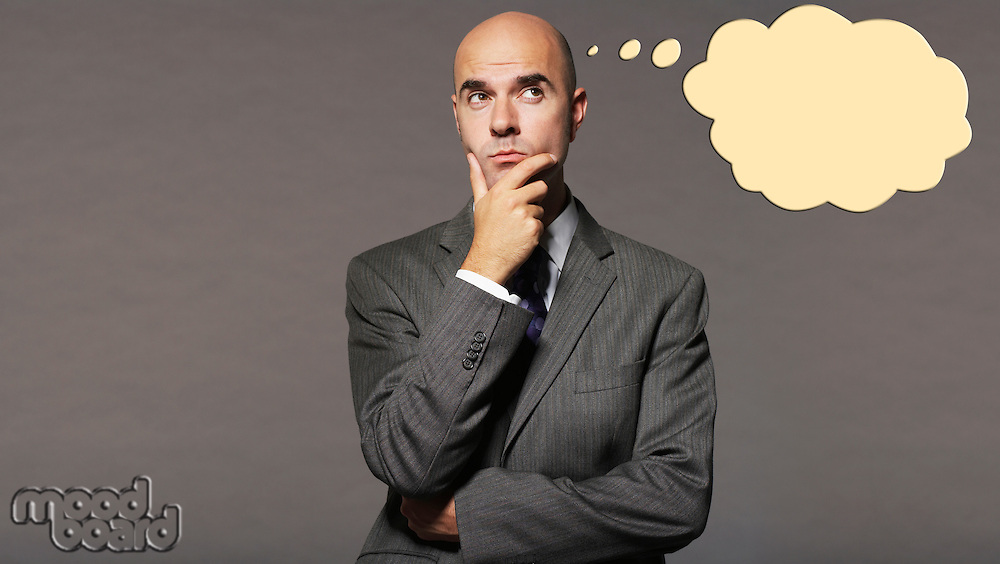 Bald businessman thinking with speech bubble over gray background
