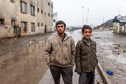 "Portrait of two young residents at the Roma settlement located at ""Budulovska Street"" in Moldava nad Bodvou about 30 km from Kosice. In 2015 the ""muddy"" roads to and in the settlement were asphalted and the infrastructure for the residents  improved. From about 800 inhabitants of the segregated settlement 'Budulovska Street' (2014) are roughly 392 children up to the age of 16 years."