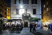 ROME, ITALY - 20 MARCH 2017: A white LED street light illuminates Piazza della Madonna di Monti, while the streets in the background are still lit by the old sodium yellow street lights, in the Monti neighborhood in Rome, Italy, on March 20th 2017.<br /> <br /> Rome is undergoing a city-wide plan to change its public illumination from the current yellow sodium street lights CK to white LED lamps. In making the change, Rome joins a long line of cities around the world that have switched to the cheaper, and more environmentally friendly LED lighting, and it is not the first city where that change has come at the price of protest.<br /> <br /> Since July, some 100,000 led lights have already been installed, just over half the number that will be substituted in the 53 million euro changeover that is expected to save the city millions of euros in electrical bills. But when Rome's municipal electrical utility ACEA began to substitute the lamps in Rome's historic center, residents began to take note.