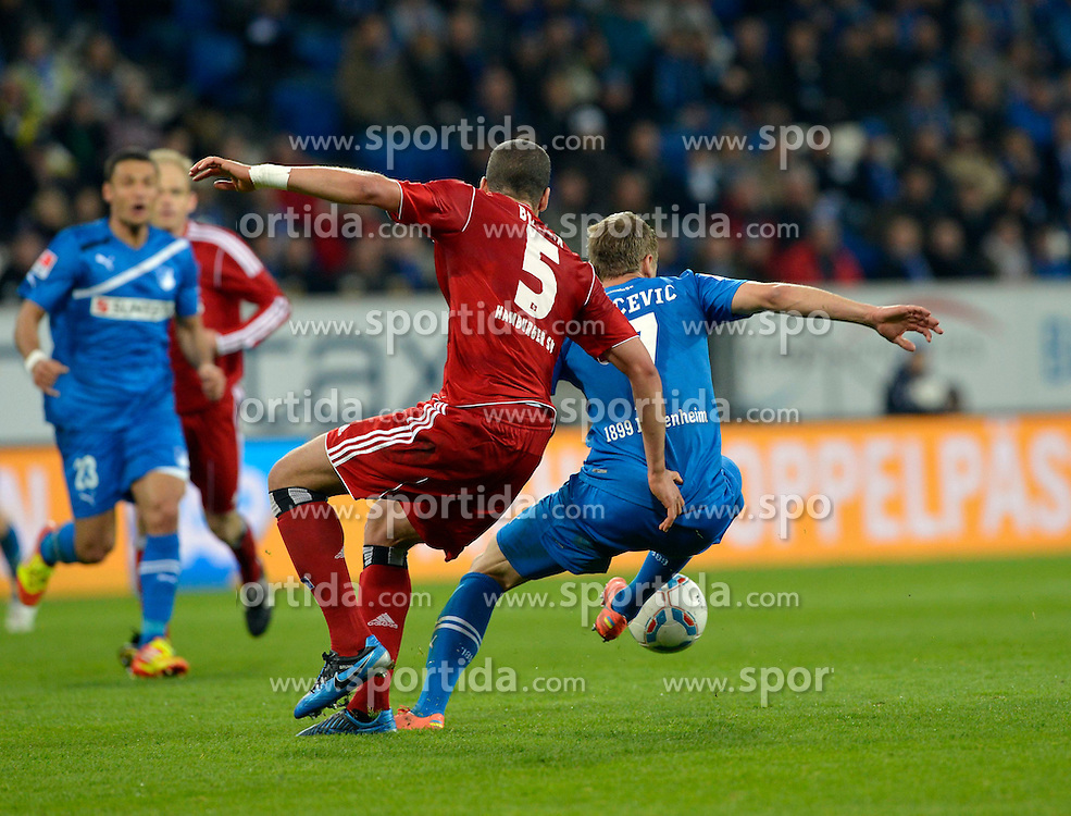 11.04.2012, Wirsol Rhein-Neckar-Arena, Sinsheim, GER, 1. FBL, TSG 1899 Hoffenheim vs Hamburger SV, 30. Spieltag, im Bild Jeffrey BRUMA HSV (rot) foult Boris VUKCEVIC TSG 1899 Hoffenheim (rechts) Zweikampf Aktion // during the German Bundesliga Match, 30th Round between TSG 1899 Hoffenheim and Hamburger SV at the Wirsol Rhein Neckar Arena, Sinsheim, Germany on 2012/04/11. EXPA Pictures © 2012, PhotoCredit: EXPA/ Eibner/ Weber..***** ATTENTION - OUT OF GER *****