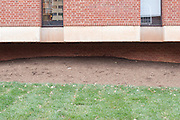 Strips of brick, mulch, and grass from the exterior of the University of Virginia Fiske Kimball Fine Arts Library recreate a traditional landscape  in Charlottesville, Virginia