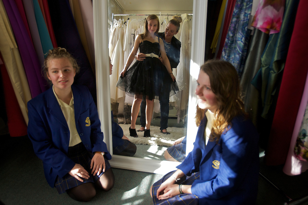 Amanda Stoke loans formal wear dresses to school girls, in dress is Magda Celjewsa 17yrs, watching on are friends left Iva Giusti 19 and Emily Payne 18. Pic By Craig Sillitoe CSZ/The Sunday Age.3/8/2011  Dress Loaning, Amanda Stokes loans dresses, trying on is Magda Celejelewsa, as friends watch, Emily Payne (left) &amp; Iva Giusti. Pic By Craig Sillitoe CSZ/The Sunday Age.4/8/2011 melbourne photographers, commercial photographers, industrial photographers, corporate photographer, architectural photographers, This photograph can be used for non commercial uses with attribution. Credit: Craig Sillitoe Photography / http://www.csillitoe.com<br />
