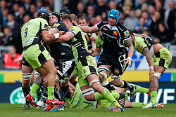 Exeter Chiefs Number 8 Thomas Waldrom is tackled by Northampton Scrum-Half Kahn Fotuali'i and Flanker Calum Clark - Photo mandatory by-line: Rogan Thomson/JMP - 07966 386802 - 11/04/2015 - SPORT - RUGBY UNION - Exeter, England - Sandy Park Stadium - Exeter Chiefs v Northampton Saints - Aviva Premiership.
