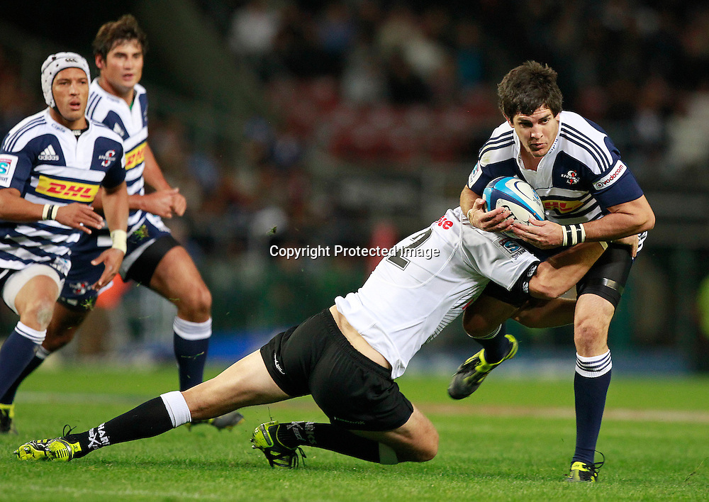 Sharks centre Meyer Bosman (L) tackles Stormers centre Jaque Fourie (R) during their Super Rugby match in Cape Town, South Africa 30 April 2011
