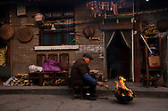 Man in the court yard of his house, Langzhong, Sichuan Province