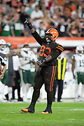 Cleveland Browns defensive tackle Trevon Coley (93) points as he celebrates after making a quarterback sack for a loss of 2 yards at the New York Jets 29 yard line with 23 seconds left in the fourth quarter during the 2018 NFL regular season week 3 football game against the New York Jets on Thursday, Sept. 20, 2018 in Cleveland. The Browns won the game 21-17. (©Paul Anthony Spinelli)