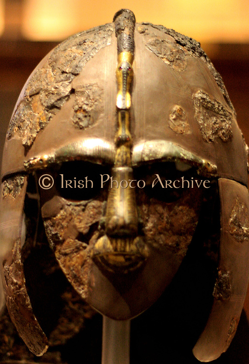 Sutton Hoo helmet. Early 7th century AD, England. One of only 4 early medieval helmets found in England. Made of Bronze, Silver wire and garnet. Features decorated panels depicting heroic scenes.