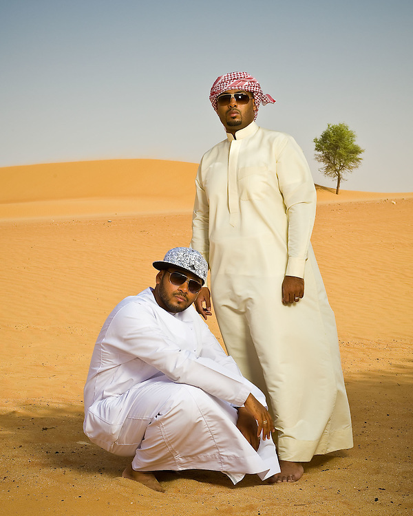 Emirati hip hop duo, Desert Heat -Salim Dahman AKA 'Illmiyah'  and Abdullah Dahman AKA 'Arableak photographed in the desert just outside Dubai.