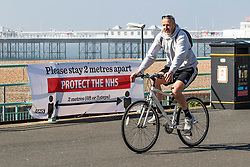 © Licensed to London News Pictures.04/04/2020. Brighton, UK. Banners advising people to stay 2 meters apart have appeared on the Brighton and Hove promenade in support of the Coronavirus social distancing. Photo credit: Hugo Michiels/LNP