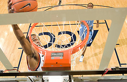 Virginia guard Sean Singletary (44) goes up for a dunk against UNC.  The Virginia Cavaliers men's basketball team faced the #3 ranked North Carolina Tar Heels  at the John Paul Jones Arena in Charlottesville, VA on February 12, 2008.