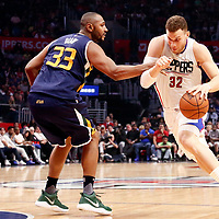 25 March 2016: LA Clippers forward Blake Griffin (32) past Utah Jazz center Boris Diaw (33) during the Los Angeles Clippers 108-95 victory over the Utah Jazz, at the Staples Center, Los Angeles, California, USA.