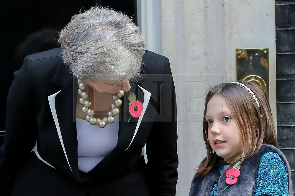 © Licensed to London News Pictures. 25/010/2018. London, UK. Prime Minister Theresa May speaks with 9 year old Poppy Railton during the launch of the National Poppy Appeal 2018 launch outside 10 Downing Street. Photo credit: Dinendra Haria/LNP
