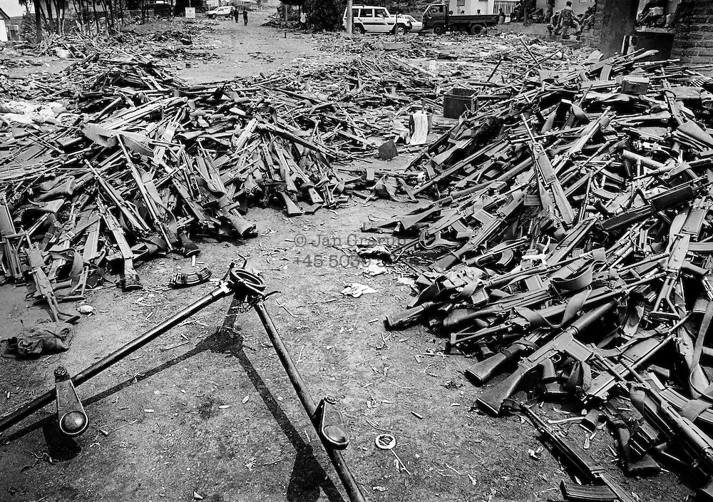 Gisenyi, on the border between Rwanda and Zaire. Following the Tutsi counter-attack, thousands of Hutus fled to the town of Goma in Zaire, including many of the militia members who had carried out massacres of Tutsis. Their weapons were abandoned in Rwanda.  April 1994.