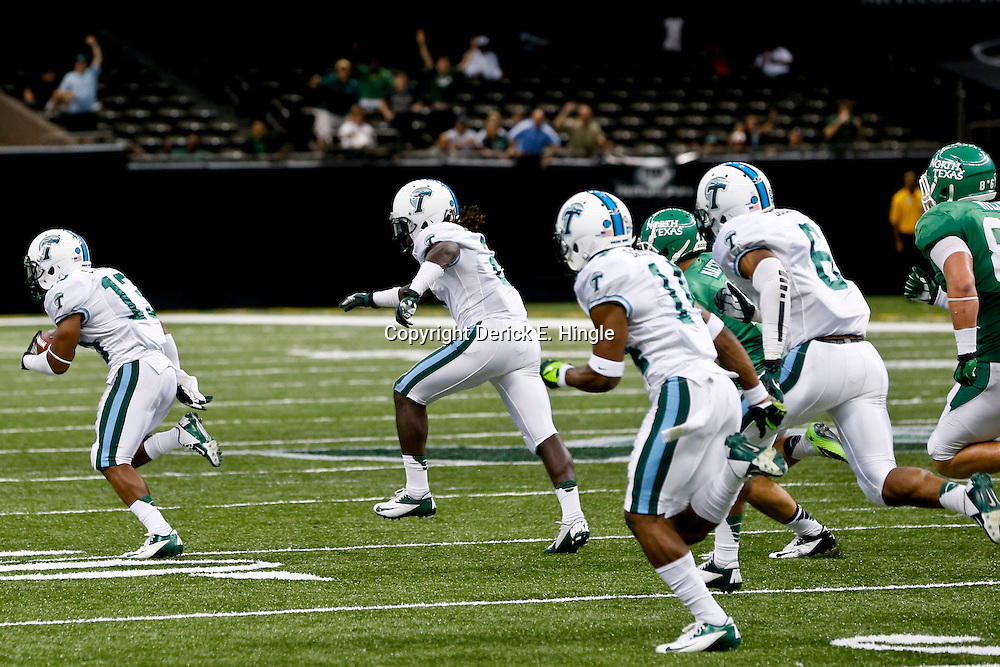 Oct 5, 2013; New Orleans, LA, USA; Tulane Green Wave cornerback Derrick Strozier (13) runs a blocked field goal back for a touchdown against the North Texas Mean Green during the third quarter at Mercedes-Benz Superdome. Tulane defeated North Texas 24-21. Mandatory Credit: Derick E. Hingle-USA TODAY Sports