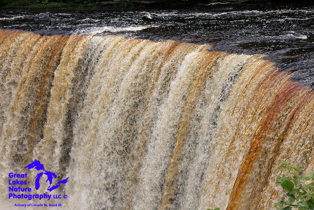 The richly tannin-colored water of the Tahquamenon River makes its way over the Upper Tahquamenon Falls. Locals have long referred to this place as Root Beer Falls.