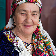 An older woman in traditional dress and scarf, Ashgabat, Turkmenistan