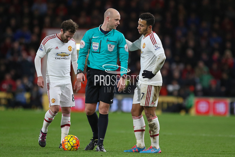 Referee Anthony Taylor speaks with Memphis Depay of Manchester United during the Barclays Premier League match between Bournemouth and Manchester United at the Goldsands Stadium, Bournemouth, England on 12 December 2015. Photo by Phil Duncan.