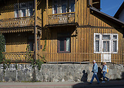 Locals walk past old architecture of a property in Szczawnica, on 21st September 2019, in Szczawnica, Malopolska, Poland.