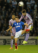 Oliver Norwood beats Conor Chaplin to the ball during the Capital One Cup match between Portsmouth and Reading at Fratton Park, Portsmouth, England on 25 August 2015. Photo by Adam Rivers.