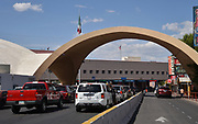 Passenger vehicles wait at Puerto Fronterizo Nogales I Y II at the international border in Nogales, Sonora, Mexico, to pass through U.S. customs inspections at the DeConcini Port of Entry to enter Nogales, Arizona, USA.