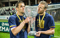 Mitja Viler #28 of NK Maribor and Ales Mertelj #70 of NK Maribor celebrate with a trophy after winning during football match between NK Celje and NK Maribor in Final of Slovenian Cup 2016, on May 25, 2016 in Stadium Bonifika, Koper, Slovenia. Photo by Vid Ponikvar / Sportida