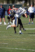 Tight end Brock Edwards avoids a tackle during workouts at the San Diego Chargers summer training camp at the Home Depot National Training Center in Carson, CA on 08/04/2004. ©Paul Anthony Spinelli
