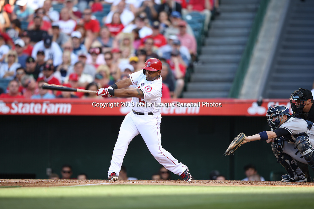 ANAHEIM, CA - JUNE 15:  Alberto Callaspo #6 of the Los Angeles Angels of Anaheim bats during the game against the New York Yankees on Saturday, June 15, 2013 at Angel Stadium in Anaheim, California. The Angels won the game 6-2. (Photo by Paul Spinelli/MLB Photos via Getty Images) *** Local Caption *** Alberto Callaspo