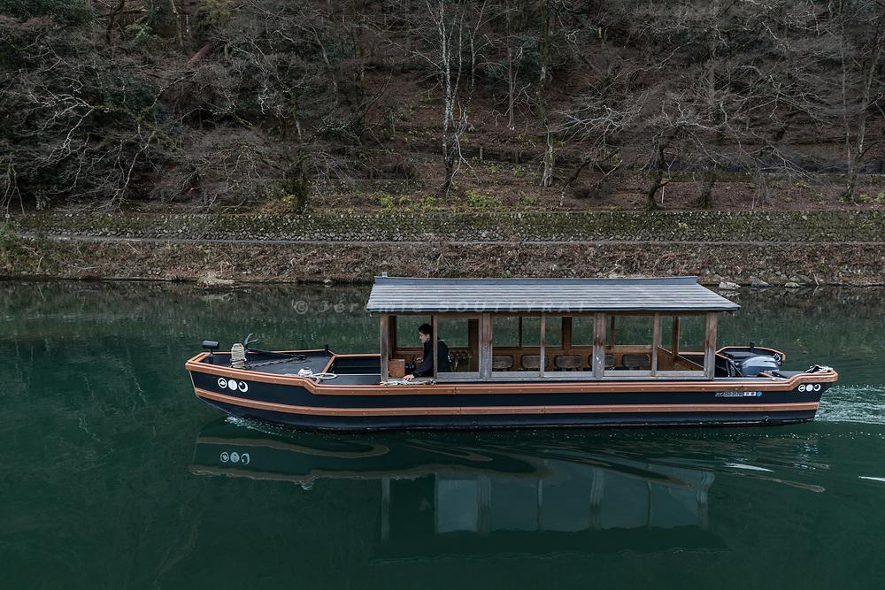 Kyoto, Japan, February 22 2018 - Aarrival by boat at Hoshinoya Kyoto, a luxury ryokan on the border of Katsura river in the Arashiyama restaurant.