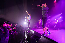 """© Licensed to London News Pictures. 01/03/2014. London, UK.   Rizzle Kicks performing live at Hammersmith Apollo. In this picture - Harley Alexander-Sule (centre), Jordan Stephens (right).  Rizzle Kicks are an English hip hop duo from Brighton, consisting of Jordan """"Rizzle"""" Stephens and Harley """"Sylvester"""" Alexander-Sule.   Photo credit : Richard Isaac/LNP"""