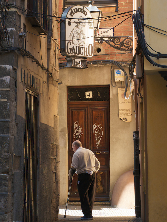 In an alley way off a main street in Leon, North Spain, an old man turns a corner. The old town of Leon is full of small winding alleys off the Medieval main streets.