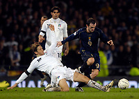 Photo: Jed Wee/Sportsbeat Images.<br /> Scotland v Italy. UEFA European Championships Qualifying. 17/11/2007.<br /> <br /> Scotland's James McFadden (R) is tackled by Italy's Massimo Ambrosini.