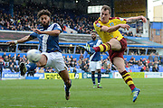 Birmingham City defender Ryan Shotton attempts to block Burnley striker Ashley Barnes's shot during the Sky Bet Championship match between Birmingham City and Burnley at St Andrews, Birmingham, England on 16 April 2016. Photo by Alan Franklin.