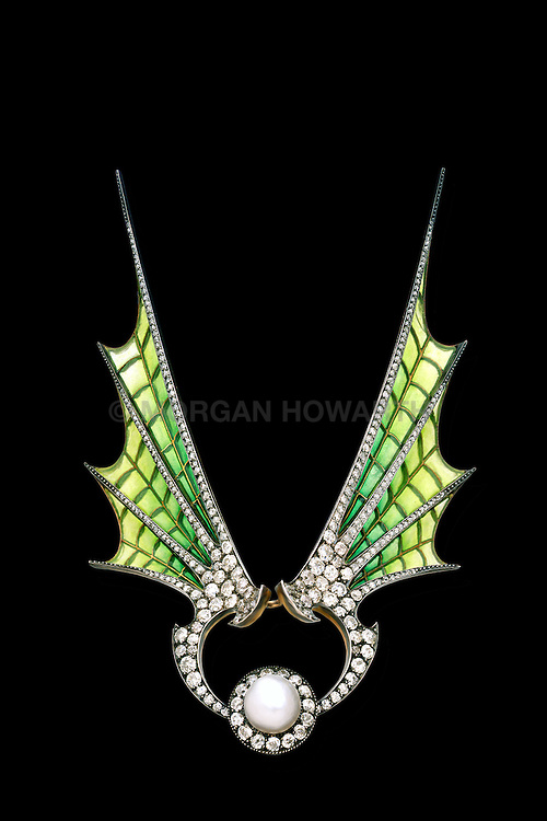 lique-a-jour enamel spead over the wings with diamond borders centering a natural pearl surrounded by old cut diamond on gold by Maison Vever. Diamond tiara and convertible brooch with enameled bat wings and giant pearl