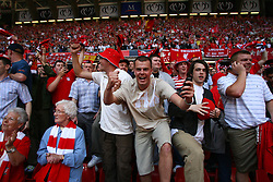 CARDIFF, WALES - SATURDAY, MAY 13th, 2006: Liverpool fans celebrate winning the FA Cup after a penalties victory over West Ham United during the FA Cup Final at the Millennium Stadium. (Pic by David Rawcliffe/Propaganda)