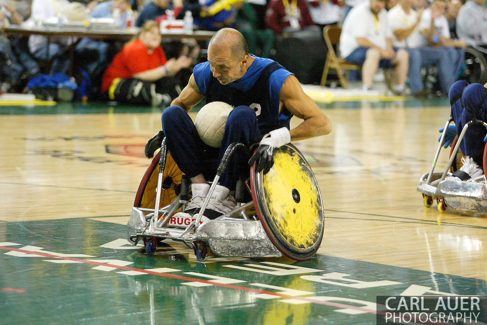 July 7th, 2006: Anchorage, AK - David Hosick (2) speeds in to score as White defeated Blue in the gold medal game of Quad Rugby at the 26th National Veterans Wheelchair Games.