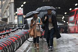 © Licensed to London News Pictures. 28/03/2018. London, UK. Commuters make their way to work from Waterloo Station during rain and wet weather this morning. Photo credit: Vickie Flores/LNP