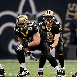 January 7, 2012; New Orleans, LA, USA; New Orleans Saints quarterback Drew Brees (9) lines up under center Brian De La Puente (60) during the 2011 NFC wild card playoff game against the Detroit Lions at the Mercedes-Benz Superdome. Mandatory Credit: Derick E. Hingle-US PRESSWIRE