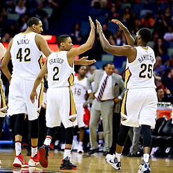 Mar 31, 2016; New Orleans, LA, USA; New Orleans Pelicans guard Tim Frazier (2) celebrates with teammates forward Luke Babbitt (8) and center Alexis Ajinca (42) and guard Jordan Hamilton (25) and forward James Ennis (4) after a basket during the second half of a game against the Denver Nuggets at the Smoothie King Center. The Pelicans defeated the Nuggets 101-95. Mandatory Credit: Derick E. Hingle-USA TODAY Sports