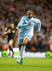 MANCHESTER, ENGLAND - Monday, April 30, 2012: Manchester City's Yaya Toure in action against Manchester United during the Premiership match at the City of Manchester Stadium. (Pic by David Rawcliffe/Propaganda)