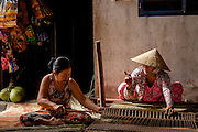 Women make jute mats on Binh Thanh Island, Vietnam.