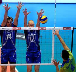 21-09-2013 VOLLEYBAL: EK MANNEN SLOVENIE - FINLAND: HERNING<br /> Konstantin Shumov, Olli Kunnari<br /> ©2013-FotoHoogendoorn.nl<br />  / SPORTIDA