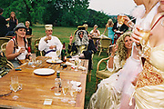 Costumed punters in fancy dress eating and drinking outdoors, Posh at Addington Palace, UK, August, 2004