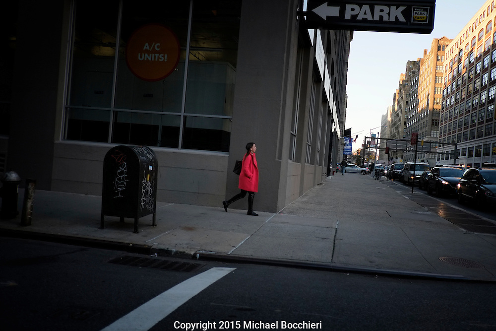 NEW YORK, NY - October 19:  A woman in a bright colored coat walks down the street on October 19, 2015 in NEW YORK, NY.  (Photo by Michael Bocchieri/Bocchieri Archive)