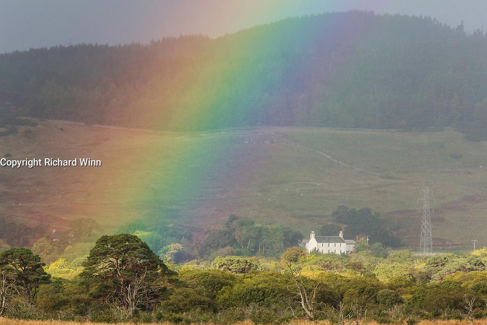 Rainbow formed over a farmstead near Loch Fleet.