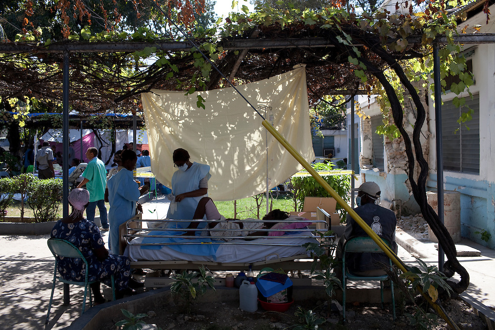 A girl is treated outside in the courtyard at the St. Francois De Sales hospital in Port-au-Prince, Haiti. The hospital's main building collapsed in the recent earthquake.