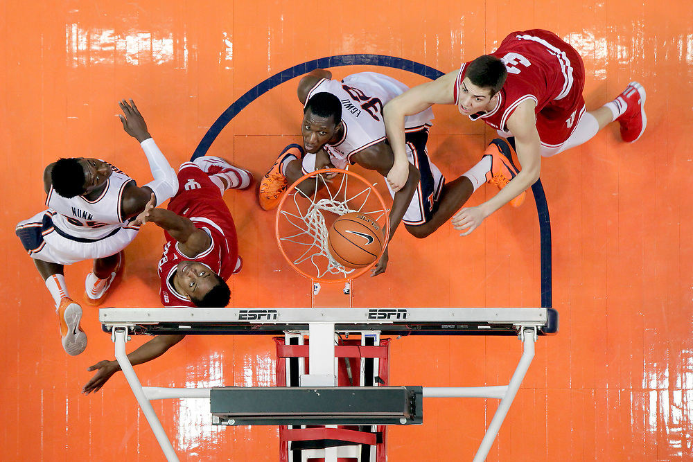 Illinois guard Kendrick Nunn (25) and forward/center Nnanna Egwu (32) eye a rebound against Indiana guard Yogi Ferrell (11) and forward Max Hoetzel (3) during an NCAA college basketball game at the State Farm Center Sunday, Jan. 18, 2015, on the University of Illinois campus in Champaign, Ill. Indiana won the game 80-74. (For the Herald & Review/ Stephen Haas)
