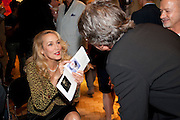 JERRY HALL; WARWICK HEMSLEY;, Macmillan De'Longhi Art Auction 2011, Bonhams, 101 New Bond Street, London, 27 September 2011. Annual art sale supported by appliances manufacturer De'Longhi to raise funds for cancer care charity Macmillan. <br /> <br />  , -DO NOT ARCHIVE-© Copyright Photograph by Dafydd Jones. 248 Clapham Rd. London SW9 0PZ. Tel 0207 820 0771. www.dafjones.com.