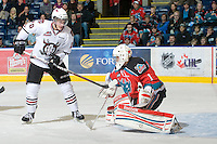 KELOWNA, CANADA, NOVEMBER 9: Turner Elson #10 of the Red Deer Rebels takes a shot on net of Adam Brown #1 of the Kelowna Rockets as the Red Deer Rebels visit the Kelowna Rockets  on November 9, 2011 at Prospera Place in Kelowna, British Columbia, Canada (Photo by Marissa Baecker/Shoot the Breeze) *** Local Caption ***